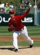 Mar 16, 2014; Tempe, AZ, USA; Los Angeles Angels starting pitcher C.J. Wilson (33) throws in the first inning against the Seattle Mariners at Tempe Diablo Stadium. Mandatory Credit: Rick Scuteri-USA TODAY Sports