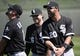 Mar 16, 2014; Surprise, AZ, USA; Chicago White Sox outfielder Jordan Danks (20) talks with first baseman Paul Konerko (14) and infielder Andy Wilkins (76) prior to the game against the Texas Rangers at Surprise Stadium. Mandatory Credit: Christopher Hanewinckel-USA TODAY Sports