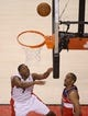 Feb 27, 2014; Toronto, Ontario, CAN; Toronto Raptors point guard Kyle Lowry (7) scores a basket against the Washington Wizards at Air Canada Centre. The Wizards beat the Raptors 134-129 in triple overtime. Mandatory Credit: Tom Szczerbowski-USA TODAY Sports