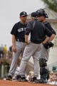 Feb 26, 2014; Bradenton, FL, USA; New York Yankees starting pitcher Bruce Billings (74) talks with pitching coach Larry Rothschild (58) and catcher Brian McCann (34) on the mound against the Pittsburgh Pirates  at McKechnie Field. Mandatory Credit: Kim Klement-USA TODAY Sports