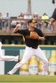 Feb 26, 2014; Bradenton, FL, USA; Pittsburgh Pirates shortstop Jordy Mercer (10) throws the ball for a double play against the New York Yankees at McKechnie Field. Mandatory Credit: Kim Klement-USA TODAY Sports