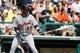Mar 2, 2014; Lake Buena Vista, FL, USA; Detroit Tigers shortstop Eugenio Suarez (27) at bat against the Atlanta Braves at Champion Stadium. Mandatory Credit: Kim Klement-USA TODAY Sports