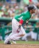 Mar 17, 2014; Fort Myers, FL, USA; Boston Red Sox second baseman Dustin Pedroia (15) drives in a run during the fifth inning against the St. Louis Cardinals at JetBlue Park. The Boston Red Sox defeated the St. Louis Cardinals 10-5. Mandatory Credit: Jerome Miron-USA TODAY Sports