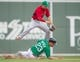 Mar 17, 2014; Fort Myers, FL, USA; St. Louis Cardinals shortstop Pete Kozma (38) turns a double play as Boston Red Sox first baseman Brandon Snyder (23) slides into second base during the sixth inning at JetBlue Park. The Boston Red Sox defeated the St. Louis Cardinals 10-5. Mandatory Credit: Jerome Miron-USA TODAY Sports