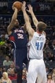 Mar 17, 2014; Charlotte, NC, USA; Atlanta Hawks forward Mike Scott (32) shoots the ball over Charlotte Bobcats center Cody Zeller (40) during the first half at Time Warner Cable Arena. Mandatory Credit: Jeremy Brevard-USA TODAY Sports
