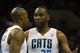 Mar 17, 2014; Charlotte, NC, USA; Charlotte Bobcats center Al Jefferson (25) talks with forward Anthony Tolliver (43) during the first half against the Atlanta Hawks at Time Warner Cable Arena. Mandatory Credit: Jeremy Brevard-USA TODAY Sports