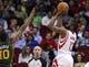 Mar 17, 2014; Houston, TX, USA; Houston Rockets guard James Harden (13) shoots during the first quarter as Utah Jazz guard Alec Burks (10) defends at Toyota Center. Mandatory Credit: Troy Taormina-USA TODAY Sports
