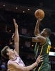 Mar 17, 2014; Houston, TX, USA; Utah Jazz center Derrick Favors (15) shoots the ball over Houston Rockets center Omer Asik (3) during the first quarter at Toyota Center. Mandatory Credit: Troy Taormina-USA TODAY Sports