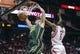 Mar 17, 2014; Houston, TX, USA; Utah Jazz guard Gordon Hayward (20) dunks the ball during the first quarter as Houston Rockets forward Terrence Jones (6) defends at Toyota Center. Mandatory Credit: Troy Taormina-USA TODAY Sports