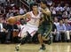 Mar 17, 2014; Houston, TX, USA; Houston Rockets guard Jeremy Lin (7) drives to the basket during the fourth quarter as Utah Jazz guard Trey Burke (3) defends at Toyota Center. Mandatory Credit: Troy Taormina-USA TODAY Sports