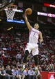 Mar 17, 2014; Houston, TX, USA; Houston Rockets guard Jeremy Lin (7) scores during the fourth quarter against the Utah Jazz at Toyota Center. Mandatory Credit: Troy Taormina-USA TODAY Sports