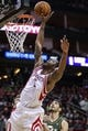 Mar 17, 2014; Houston, TX, USA; Houston Rockets forward Terrence Jones (6) shoots during the third quarter against the Utah Jazz at Toyota Center. The Rockets defeated the Jazz 124-86. Mandatory Credit: Troy Taormina-USA TODAY Sports