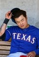 Mar 18, 2014; Phoenix, AZ, USA; Texas Rangers outfielder Shin-Soo Choo reacts in the dugout against the Milwaukee Brewers at Maryvale Baseball Park. Mandatory Credit: Mark J. Rebilas-USA TODAY Sports