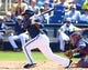 Mar 18, 2014; Phoenix, AZ, USA; Milwaukee Brewers batter Rickie Weeks bats against the Texas Rangers at Maryvale Baseball Park. Mandatory Credit: Mark J. Rebilas-USA TODAY Sports