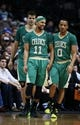 Mar 17, 2014; Dallas, TX, USA; Boston Celtics guard Jerryd Bayless (11) and guard Avery Bradley (0) and center Kris Humphries (back) react during the game against the Dallas Mavericks at American Airlines Center. Dallas won 94-89. Mandatory Credit: Kevin Jairaj-USA TODAY Sports
