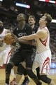 Mar 20, 2014; Houston, TX, USA; Minnesota Timberwolves center Gorgui Dieng (5) is fouled by Houston Rockets center Omer Asik (3) during the third quarter at Toyota Center. Mandatory Credit: Andrew Richardson-USA TODAY Sports
