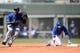 Mar 22, 2014; Surprise, AZ, USA; Texas Rangers second baseman Jurickson Profar (13) reacts after Kansas City Royals shortstop Alcides Escobar (2) was called safe at second base with a double at Surprise Stadium. Mandatory Credit: Joe Camporeale-USA TODAY Sports