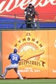 Mar 22, 2014; Surprise, AZ, USA; Texas Rangers center fielder Jim Adduci (35) plays a ball off the wall in the eighth inning against the Kansas City Royals at Surprise Stadium. The Royals won 8-4. Mandatory Credit: Joe Camporeale-USA TODAY Sports