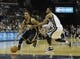 Mar 22, 2014; Memphis, TN, USA; Indiana Pacers guard George Hill (3) drives to the basket against Memphis Grizzlies guard Mike Conley (11) at FedExForum. Memphis Grizzlies defeat the Indiana Pacers 82 - 71. Mandatory Credit: Justin Ford-USA TODAY Sports