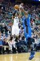 Mar 22, 2014; Salt Lake City, UT, USA; Utah Jazz guard Trey Burke (3) shoots against Orlando Magic forward Kyle O'Quinn (2) during the second half at EnergySolutions Arena. The Jazz won 89-88. Mandatory Credit: Russ Isabella-USA TODAY Sports