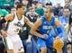 Mar 22, 2014; Salt Lake City, UT, USA; Utah Jazz guard Trey Burke (3) defends against Orlando Magic guard Arron Afflalo (4) during the second half at EnergySolutions Arena. The Jazz won 89-88. Mandatory Credit: Russ Isabella-USA TODAY Sports