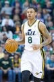 Mar 22, 2014; Salt Lake City, UT, USA; Utah Jazz guard Diante Garrett (8) dribbles up the court during the second half against the Orlando Magic at EnergySolutions Arena. The Jazz won 89-88. Mandatory Credit: Russ Isabella-USA TODAY Sports