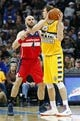 Mar 23, 2014; Denver, CO, USA; Washington Wizards center Marcin Gortat (4) guards Denver Nuggets center Timofey Mozgov (25) in the second quarter at the Pepsi Center. Mandatory Credit: Isaiah J. Downing-USA TODAY Sports