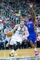 Mar 24, 2014; Salt Lake City, UT, USA; Utah Jazz guard Gordon Hayward (20) dribbles the ball around Detroit Pistons guard Rodney Stuckey (3) during the second half at EnergySolutions Arena. The Pistons won 114-94. Mandatory Credit: Russ Isabella-USA TODAY Sports