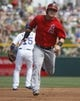 Mar 25, 2014; Mesa, AZ, USA; Los Angeles Angels right fielder Kole Calhoun (56) runs from first to third base in the first inning against the Chicago Cubs at HoHoKam Park. Mandatory Credit: Rick Scuteri-USA TODAY Sports