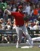 Mar 25, 2014; Mesa, AZ, USA; Los Angeles Angels third baseman David Freese (6) makes the throw for the out against the Chicago Cubs at HoHoKam Park. Mandatory Credit: Rick Scuteri-USA TODAY Sports