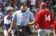 Mar 25, 2014; Mesa, AZ, USA; Los Angeles Angels manager Mike Scioscia (14) questions a call from MLB Umpire Ted Barrett (65) in the third inning against the Chicago Cubs at HoHoKam Park. Mandatory Credit: Rick Scuteri-USA TODAY Sports