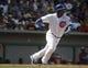 Mar 25, 2014; Mesa, AZ, USA; Chicago Cubs third baseman Luis Valbuena (24) hits against the Los Angeles Angels in the third inning at HoHoKam Park. Mandatory Credit: Rick Scuteri-USA TODAY Sports