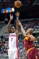 Mar 26, 2014; Auburn Hills, MI, USA; Detroit Pistons guard Brandon Jennings (7) shoots over Cleveland Cavaliers guard Jarrett Jack (1) during the first quarter at The Palace of Auburn Hills. Mandatory Credit: Tim Fuller-USA TODAY Sports