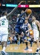 Mar 26, 2014; Salt Lake City, UT, USA; Memphis Grizzlies guard Mike Conley (11) goes up for a shot against Utah Jazz forward Marvin Williams (2) during the first half at EnergySolutions Arena. Mandatory Credit: Russ Isabella-USA TODAY Sports