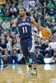 Mar 26, 2014; Salt Lake City, UT, USA; Memphis Grizzlies guard Mike Conley (11) dribbles up the court during the first half against the Utah Jazz at EnergySolutions Arena. Mandatory Credit: Russ Isabella-USA TODAY Sports