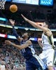 Mar 26, 2014; Salt Lake City, UT, USA; Memphis Grizzlies guard Mike Conley (11) shoots in front of Utah Jazz center Enes Kanter (0) during the first half at EnergySolutions Arena. Mandatory Credit: Russ Isabella-USA TODAY Sports
