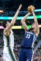 Mar 26, 2014; Salt Lake City, UT, USA; Memphis Grizzlies center Marc Gasol (33) shoots against Utah Jazz center Enes Kanter (0) during the first half at EnergySolutions Arena. Mandatory Credit: Russ Isabella-USA TODAY Sports