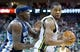 Mar 26, 2014; Salt Lake City, UT, USA; Memphis Grizzlies forward Zach Randolph (50) defends against Utah Jazz center Derrick Favors (15) during the second half at EnergySolutions Arena. The Grizzlies won 91-87. Mandatory Credit: Russ Isabella-USA TODAY Sports