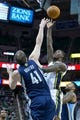 Mar 26, 2014; Salt Lake City, UT, USA; Utah Jazz forward Marvin Williams (2) shoots against Memphis Grizzlies center Kosta Koufos (41) during the second half at EnergySolutions Arena. The Grizzlies won 91-87. Mandatory Credit: Russ Isabella-USA TODAY Sports