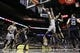 Mar 29, 2014; San Antonio, TX, USA; San Antonio Spurs guard Cory Joseph (5) shoots the ball past New Orleans Pelicans center Jeff Withey (5) during the second half at AT&T Center. The Spurs won 96-80. Mandatory Credit: Soobum Im-USA TODAY Sports