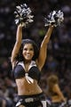 Mar 29, 2014; San Antonio, TX, USA; San Antonio Spurs cheerleader performs during the first half against the New Orleans Pelicans at AT&T Center. Mandatory Credit: Soobum Im-USA TODAY Sports