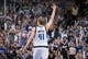 Mar 29, 2014; Dallas, TX, USA; Dallas Mavericks forward Dirk Nowitzki (41) celebrates the three point shot made by forward Shawn Marion (not pictured) against the Sacramento Kings during the second half at the American Airlines Center. The Mavericks defeated the Kings 103-100. Mandatory Credit: Jerome Miron-USA TODAY Sports