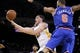 Mar 30, 2014; Oakland, CA, USA; Golden State Warriors guard Klay Thompson (11) shoots the ball in front of New York Knicks center Tyson Chandler (6) in the third quarter at Oracle Arena. The Knicks won 89-84. Mandatory Credit: Cary Edmondson-USA TODAY Sports
