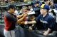 Mar 31, 2014; Milwaukee, WI, USA;   Atlanta Braves third baseman Ramiro Pena (14) signs autographs for fans during opening day of baseball game against the Milwaukee Brewers at Miller Park. Mandatory Credit: Benny Sieu-USA TODAY Sports