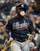 Mar 31, 2014; Milwaukee, WI, USA;   Atlanta Braves left fielder Justin Upton (8) blows a bubble during an at bat in the sixth inning against the Milwaukee Brewers of an opening day baseball game at Miller Park. Mandatory Credit: Benny Sieu-USA TODAY Sports