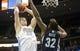 Mar 31, 2014; Denver, CO, USA; Denver Nuggets center Timofey Mozgov (25) dunks the ball over Memphis Grizzlies forward Ed David (32)  during the first half at Pepsi Center. Mandatory Credit: Chris Humphreys-USA TODAY Sports
