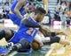 Mar 31, 2014; Salt Lake City, UT, USA; New York Knicks guard Iman Shumpert (21) and Utah Jazz guard Diante Garrett (8) battle for a loose ball during the first half at EnergySolutions Arena. Mandatory Credit: Russ Isabella-USA TODAY Sports