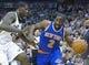 Mar 31, 2014; Salt Lake City, UT, USA; Utah Jazz forward Marvin Williams (2) defends against New York Knicks guard Raymond Felton (2) during the first half at EnergySolutions Arena. Mandatory Credit: Russ Isabella-USA TODAY Sports