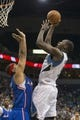 Mar 31, 2014; Minneapolis, MN, USA; Minnesota Timberwolves center Gorgui Dieng (5) goes up for a shot over Los Angeles Clippers forward Jared Dudley (9) in the second half at Target Center. The Clippers won 114-104. Mandatory Credit: Jesse Johnson-USA TODAY Sports