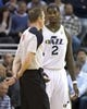 Mar 31, 2014; Salt Lake City, UT, USA; Utah Jazz forward Marvin Williams (2) talks with referee Ed Malloy (14) during the second half against the New York Knicks at EnergySolutions Arena. The Knicks won 92-83. Mandatory Credit: Russ Isabella-USA TODAY Sports